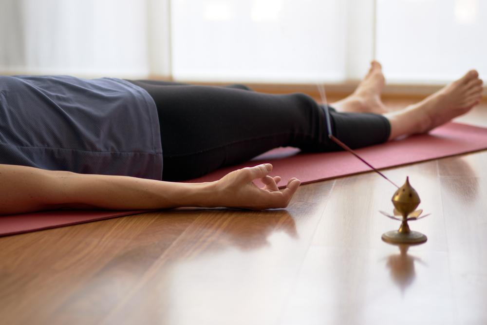 Woman,Practicing,Yoga,,Lying,In,Yoga,Nidra,Pose,,Exercise,In